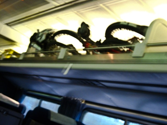 two folded bikes on train